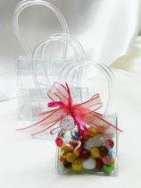 Borsetta in pvc trasparente 6 x 6 cm € 1,60 non confezionata Borsetta in pvc trasparente 8 x 8 cm€ 2,00 non confezionata,La borsettina confezionata 6 x 6 cm chiusa da un nastro in velo rosa e raso fuxia con  ciondolo  in resina, 5 confetti bianchi