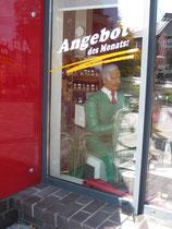 Betonfigur-alter-Mann, sitzend, zu sehen bei Joliente, Neuenkirchen