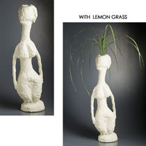WOMAN VASE . 2010 POLYSTYRENE, CONCRETE, ARCYLIC PAINT AND LEMON GRASS  H 890 X W 270 X D 170 MM AU$800