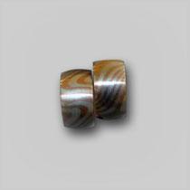 Ringe in Silber und Kupfer. In Mokume-Gane-Technik gearbeitet, Innendohlen aus Silber.