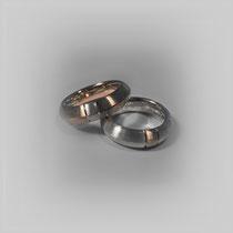 Ringe in Weiß- und Rotgold, mit einem wechselseitig eingefasstem Materialstück.