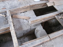 le mur de refend du vide sanitaire et le socle du conduit cheminée