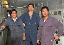 Ingenieur mit Mechanikern