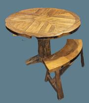 Mesa circular madera de teca con 4 bancos. 74 alto x 105 diámetro