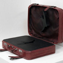Code Maroon (Stay or Go) 2-2011: found vinyl suitcase, plywood, acrylic, screws:46W x 60L x 50 H cm