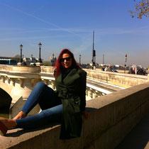 Sitting on a bridge in Paris