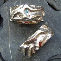 Trauringe Palladium vom Paar in Wachs geformt  und danach gegossen mit blauem Brillant