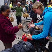 straatverkopers in Janshui