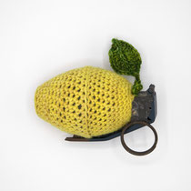 "Happiness (LemonAde), 2018.  Merino wool, cashmere, inert  ""lemon"" hand grenade (metal), nylon. 4 x 2.5 x 2.25 inches.  Private collection."