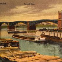 Ansichtskarte. Blick über den Kultushafen auf die 1. Rheinbrücke und die vorgelagerten Verlade-Einrichtungen. Holz war zur damaligen Zeit neben der Kohle ein häufiges Transportgut.
