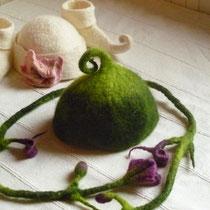 Babykappen und Blütenranke