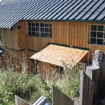 Waldburgangerhütte Holz Schindel Vordach