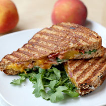 grilled peach, bacon, and arugula sandwich