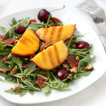 grilled peach and arugula salad with cherries, pecans, and bacon
