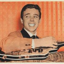 John Lamers met zijn 'dubbel nek' gitaar