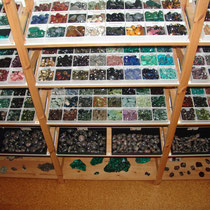 Tumbled stones on shelves 1