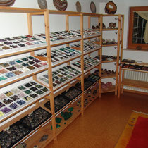 Tumbled stones on shelves 3