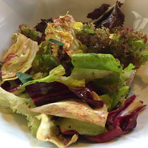 One of the best salads I've ever had.  Del Posto's bitter herbs, lettuces and chicories salad with truffled dressing.