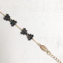 """Bracelet """"Bow"""", perles de verres, composants de bijoux plaqués or 16 K. Couleur """"Jet Black Iris"""" 42 euros"""