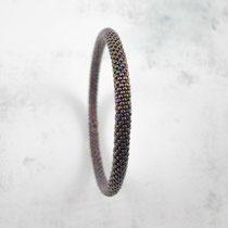 Bracelet de perles violettes irisées. 60 euros