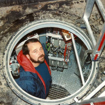 alkaSOL project: Mr. Karner working in an underground telecommunication shelter near Nahodka, Siberia / Russia