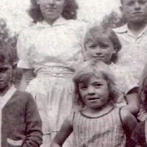 Dolly in the center with brothers and sisters