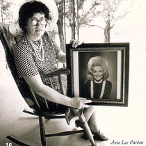 Avie Lee Parton holding a portrait of her daughter Dolly