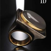 27 Brunilde in ferro con pietra di luna grigia ( disponibile bianca azzurra verde)/  Brunilde iron ring with a particular shape with a grey  moon stone- set in gold.