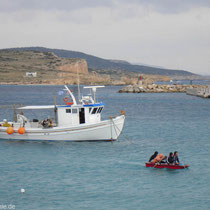 Vier Mann im Boot