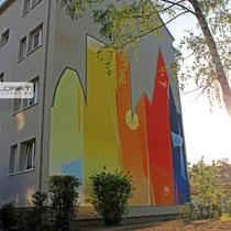 Grafftikünsteler aus Berlin Strausberg Brandenburg verschönern mit kunstvollem Bild die Giebelwand