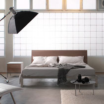 modern platform bed with wood headboard and metal base