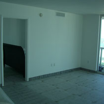 Before image of design project by Mia Home Trends featuring a staged modern living area