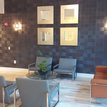 After image of completed design project by Mia Home Trends featuring a staged modern lobby area