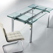 modern clear glass extension table with chrome base, white tufted faux leather (leatherette) dining chairs