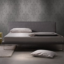 modern gray upholstered platform bed with metal sled base