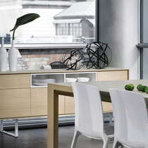 modern light natural wood buffet/sideboard with white base and multiple doors and drawers