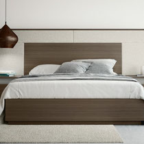 modern platform bed with wood base and headboard