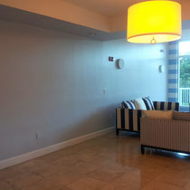 Before image of design project by Mia Home Trends featuring a staged modern lobby area