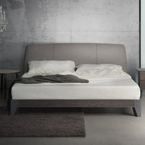 modern platform bed with uplhostered headboard and metal base