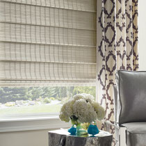 Hunter Douglas Provenance window treatments with patterned curtains in a modern setting