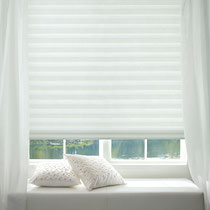 Hunter Douglas Solera window treatment with white sheers in a contemporary setting