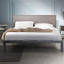 modern platform bed with gray upholstered headboard and metal base