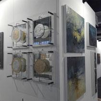 Monete scolpite, foglia oro ed argento dipinte ed installate con plexiglass e speccchio ad arte fiera