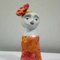Flower girl clay doll