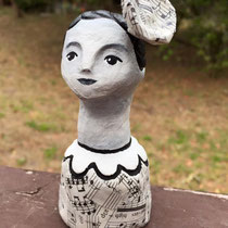 Musical girl clay doll