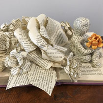 Book art from vintage book and clay