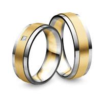 """Produktinformationen """"Nowotny Trauringe Premium Collection Ruesch in Platin/Gelbgold mit Diamant 02/40450-056_Pt""""  Gelbgold und Platin Trauringe in Premium Qualität für Brautpaare die Luxus lieben aber preisbewusst einkaufen  Die Ringe sind aus massivem"""