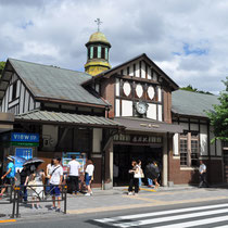 Harajuku sta. is the oldest wooden station building in Tokyo completed in 1924. It is a British style two-story building with a white outer wall and on a roof with a spire.