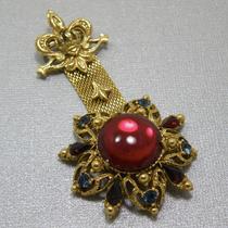P-1668. Винтажная брошь-орден от лакшери бренда FLORENZA. Ювелирный сплав оттенка античного золота, австрийские кристаллы. Длина 8см.