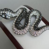 """10. Брошь """"Сверкающая змейка"""" от американского дизайнера KENNTH JAY LANE. Ювелирный сплав с серебром и родиeм, кристаллы Сваровски. Новая, в фирменной упаковке. Цена -65$"""